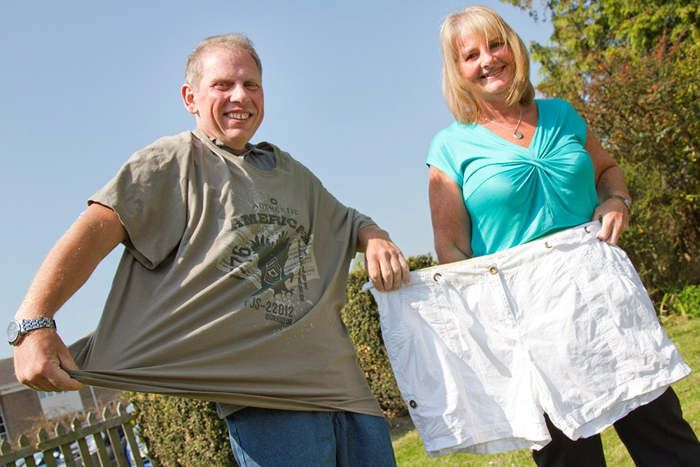 Debra and David together with old clothing before weight loss